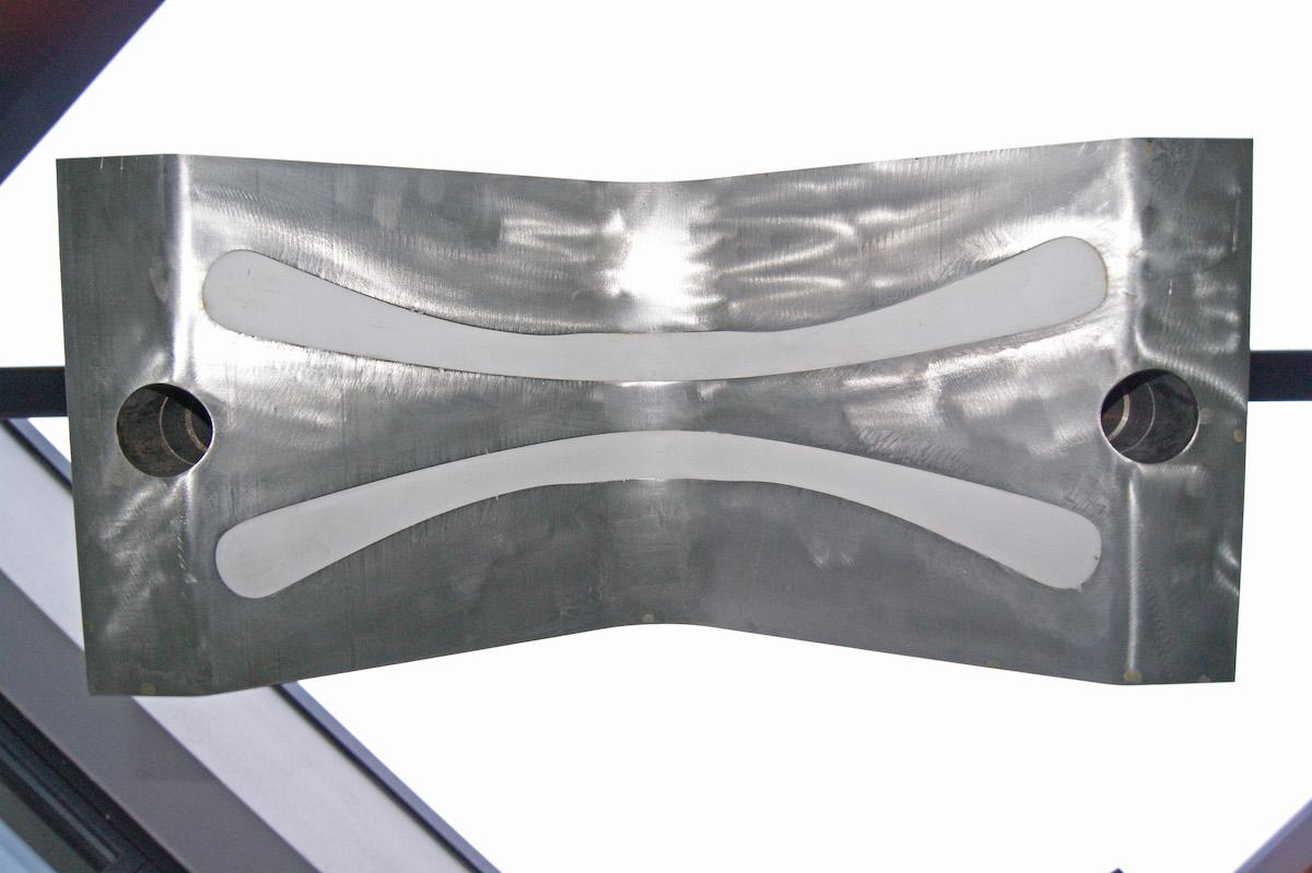 Roberto Mascella, 2011, stampo industriale in acciaio inox per la produzione di appendi abiti riempito di gesso, 60 x 40 x 37 cm